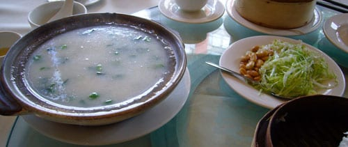 Congee with peanuts, lettuce and green onions